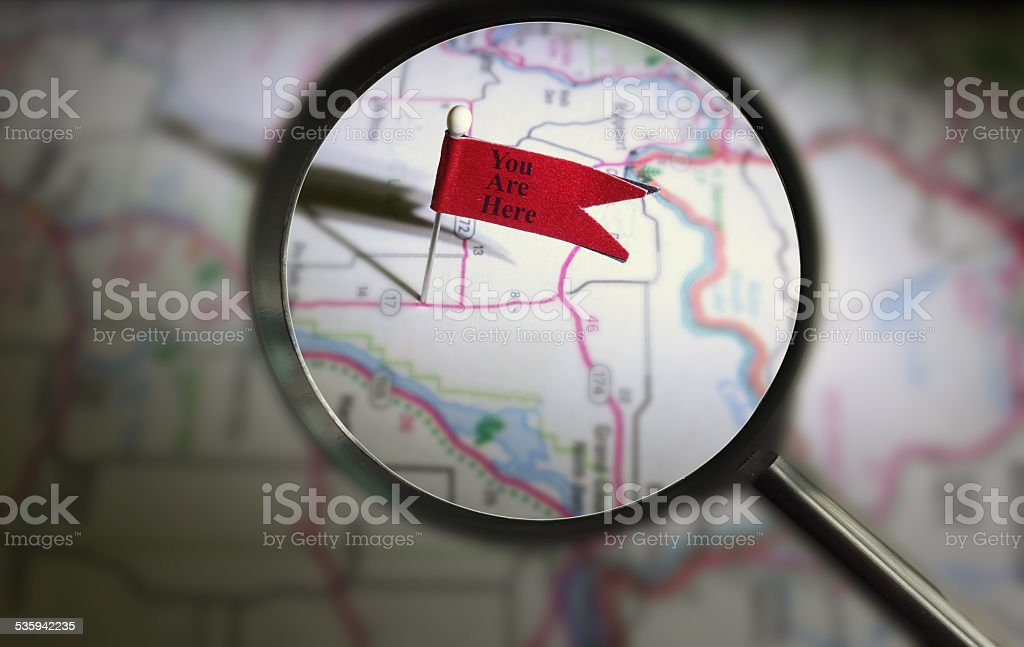 You Are Here pin magnified stock photo