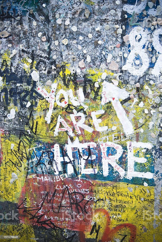 You are here written Berlin Wall, graffiti painting stock photo