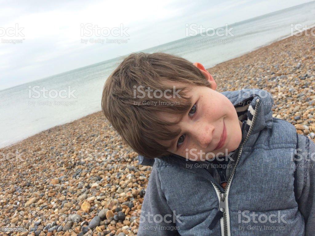 You boy on Brighton beach, England stock photo