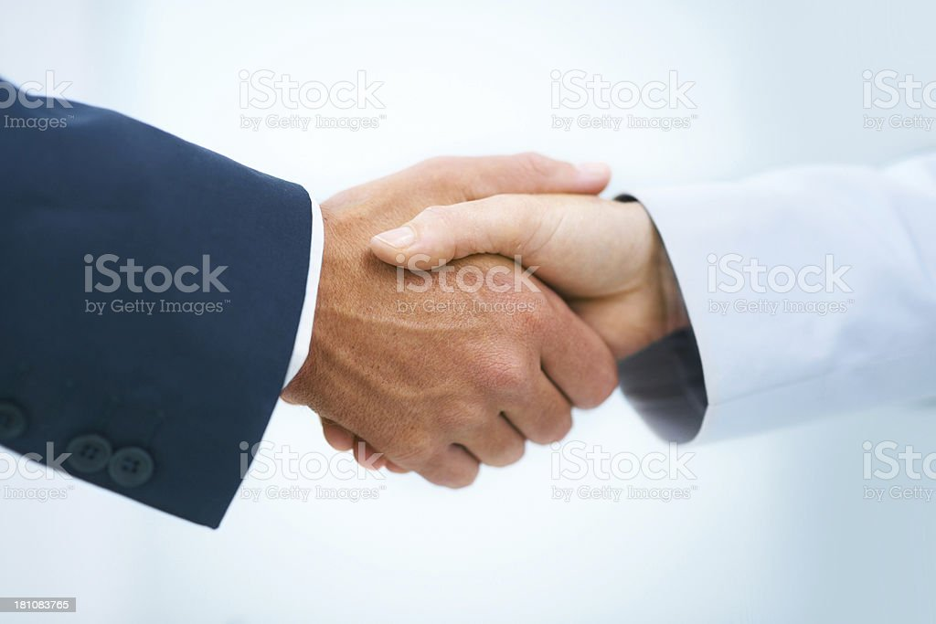 You can tell a lot by someone's handshake stock photo
