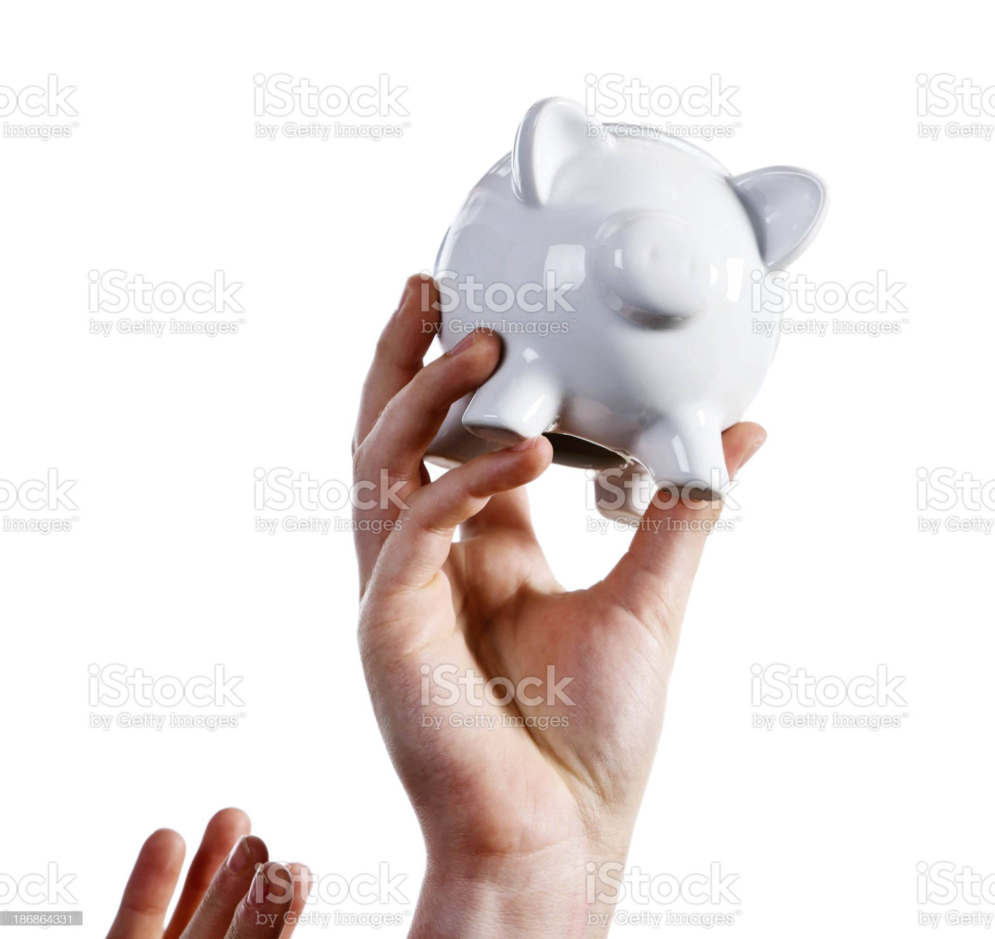 You can't have it! Hand holds piggybank out of reach royalty-free stock photo