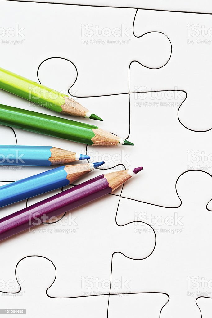 You choose the design on this jigsaw; crayons are waiting! stock photo