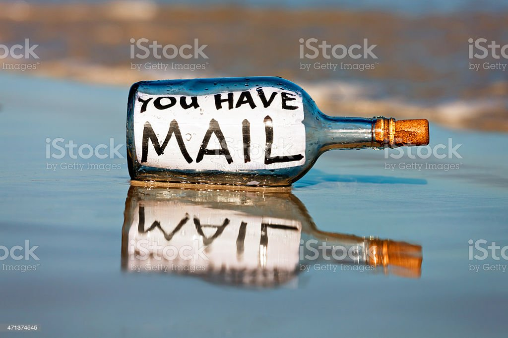 You have mail says message in bottle on shoreline stock photo