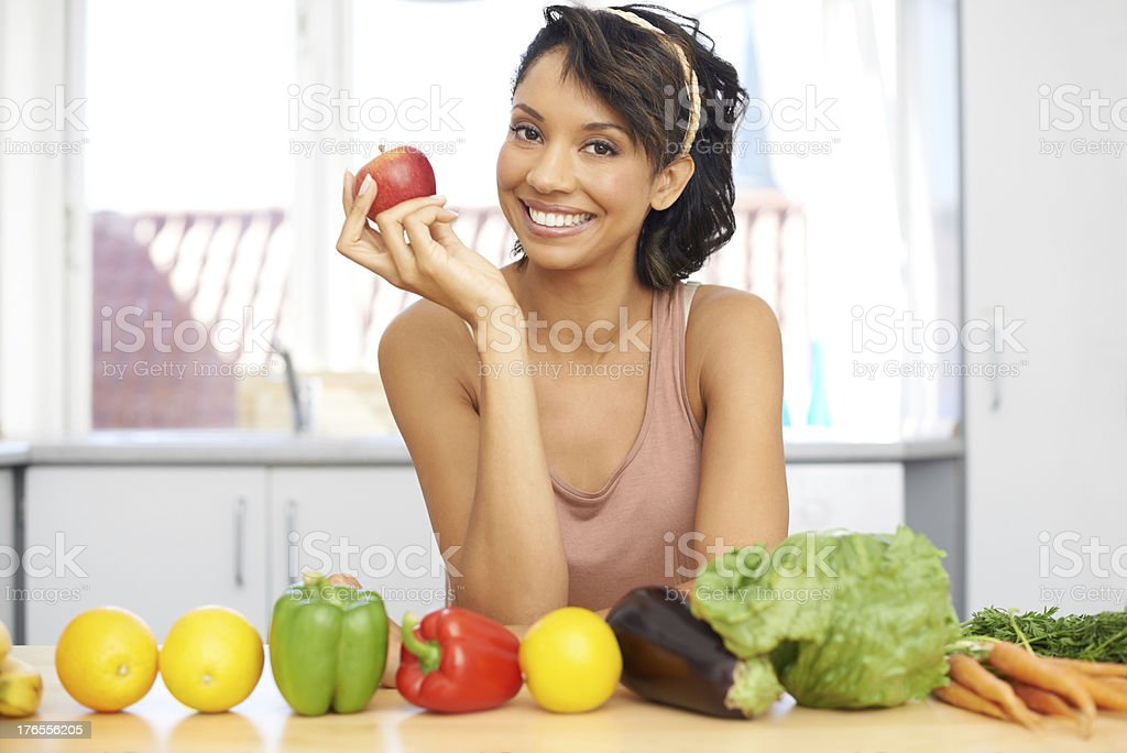 You know what they say about an apple a day... royalty-free stock photo