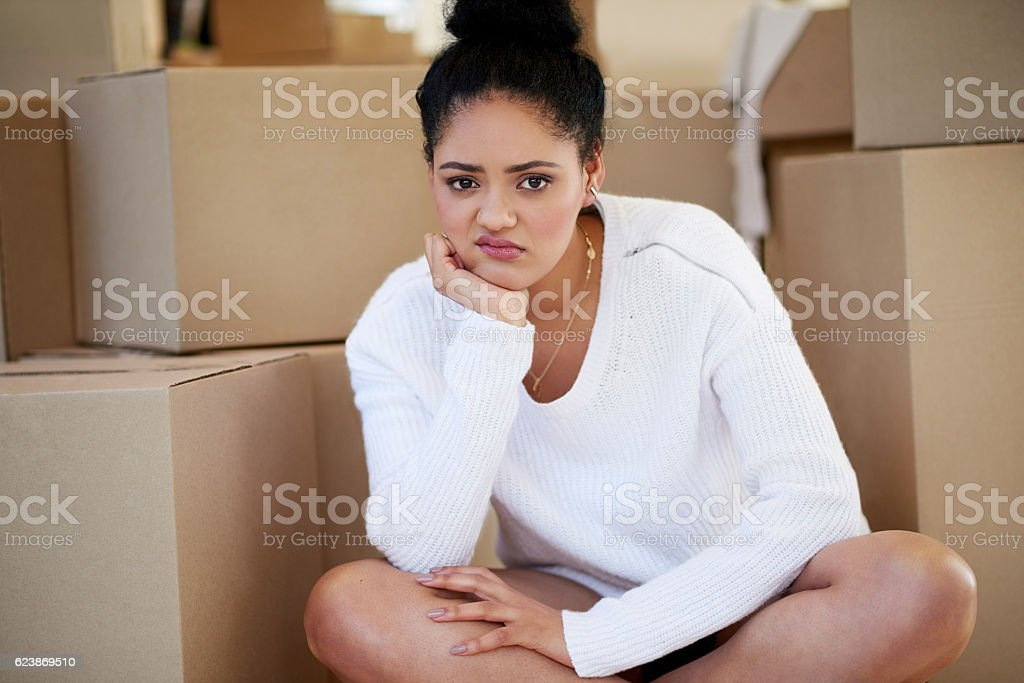 You mean I have to unpack all these boxes again? stock photo