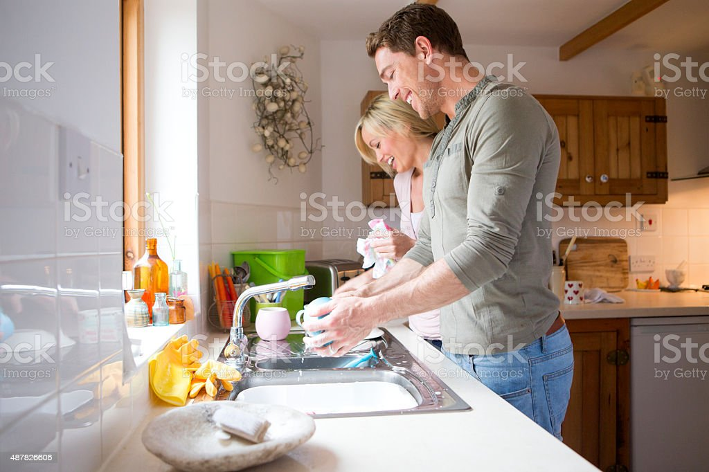 You wash, I'll dry! stock photo