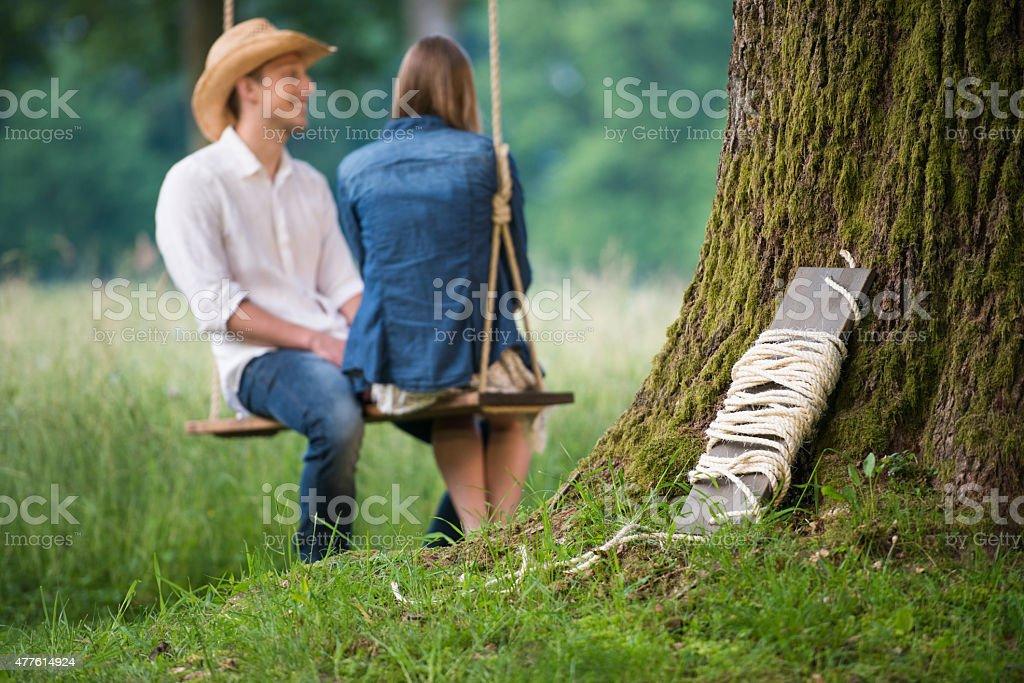 Youg Couple On A Swing stock photo