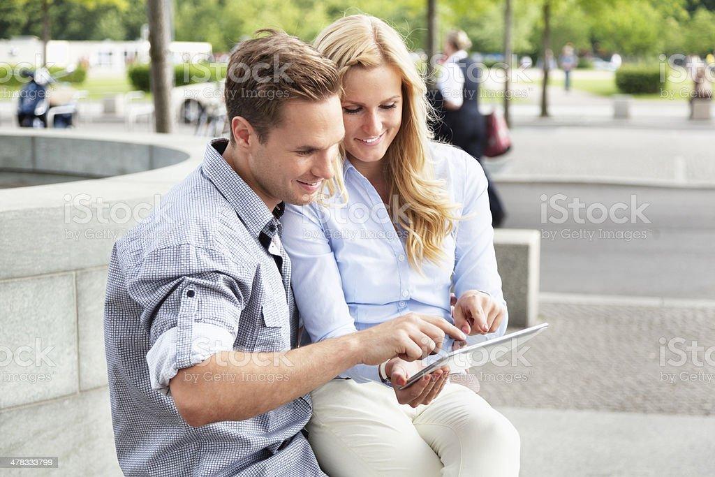 youg couple tablet pc fun stock photo
