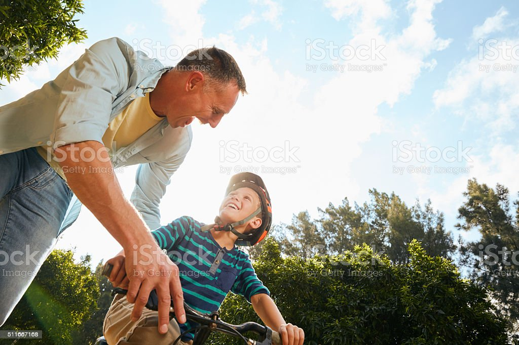 You'll be riding alone in no time! stock photo