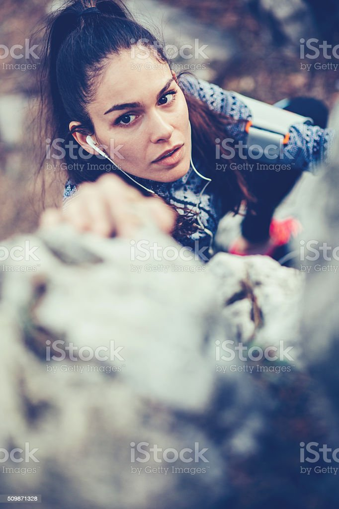 Youmg woman clambering stock photo