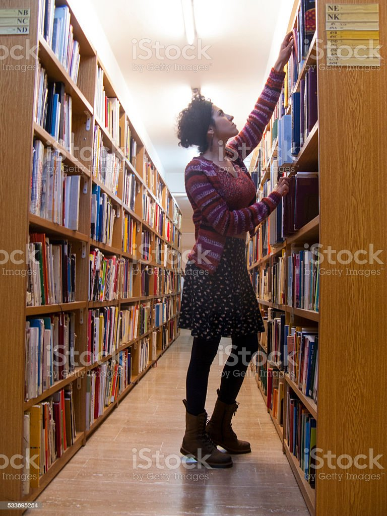 youn woman in library archive stock photo