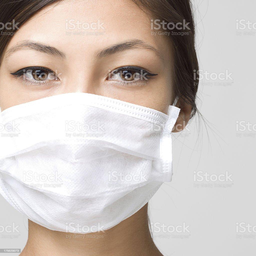 Youn Woman Wearing Medical Face Mask stock photo