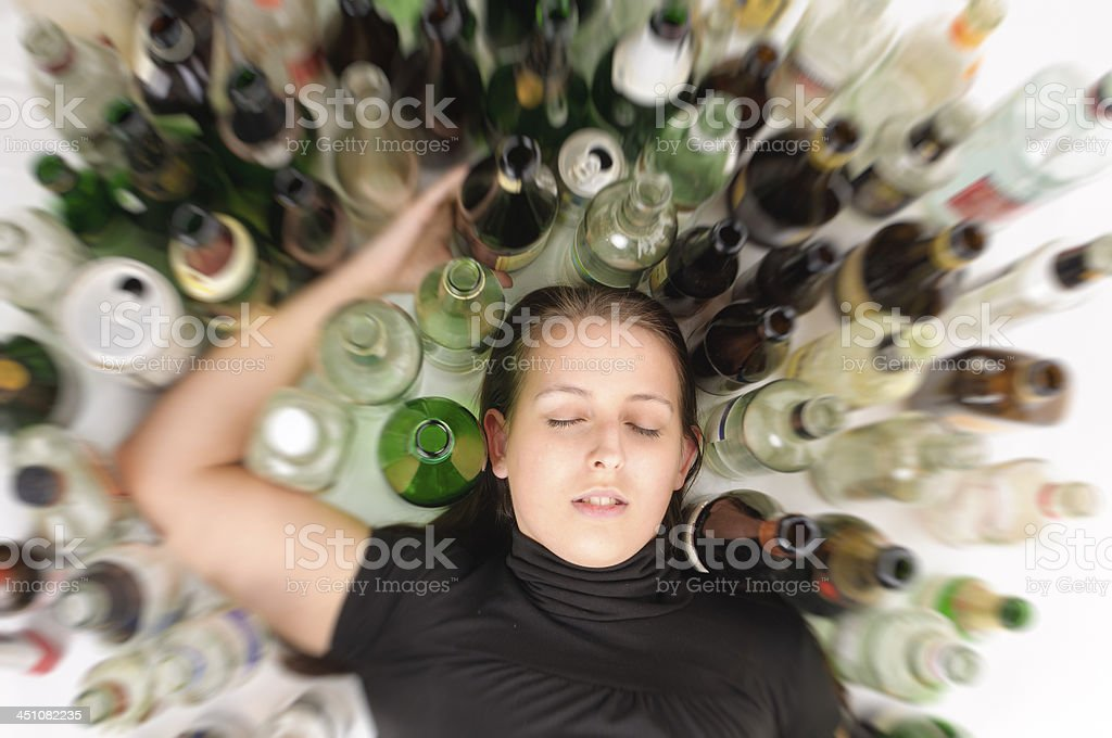 Yound beautiful woman in depression, drinking alcohol stock photo