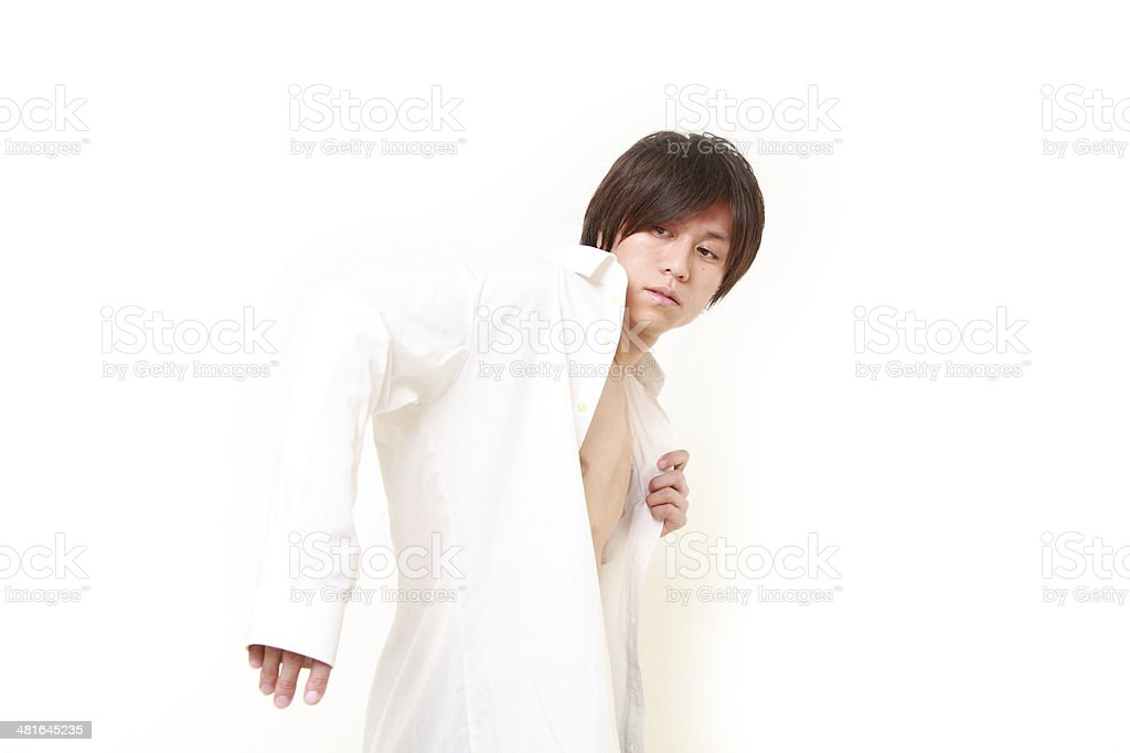 younf man getting dressed for office stock photo