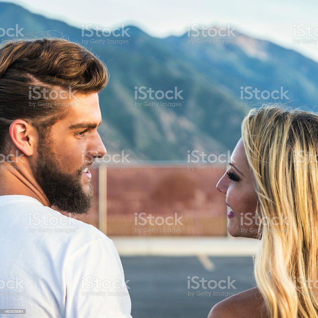 Young 1950s Heterosexual Couple Gazing Into Each Others Eyes stock photo