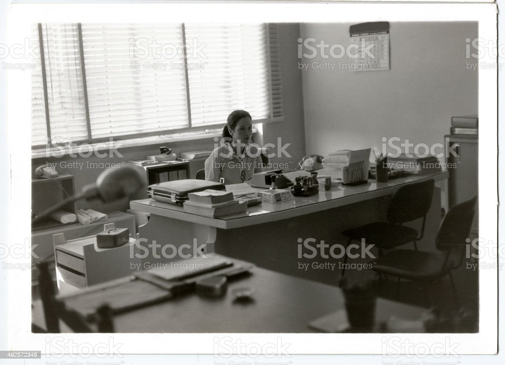 Young 1970s woman working stock photo