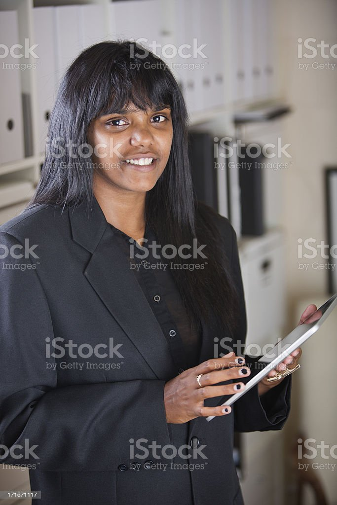 Young Aboriginal Woman Using a Tablet Computer royalty-free stock photo
