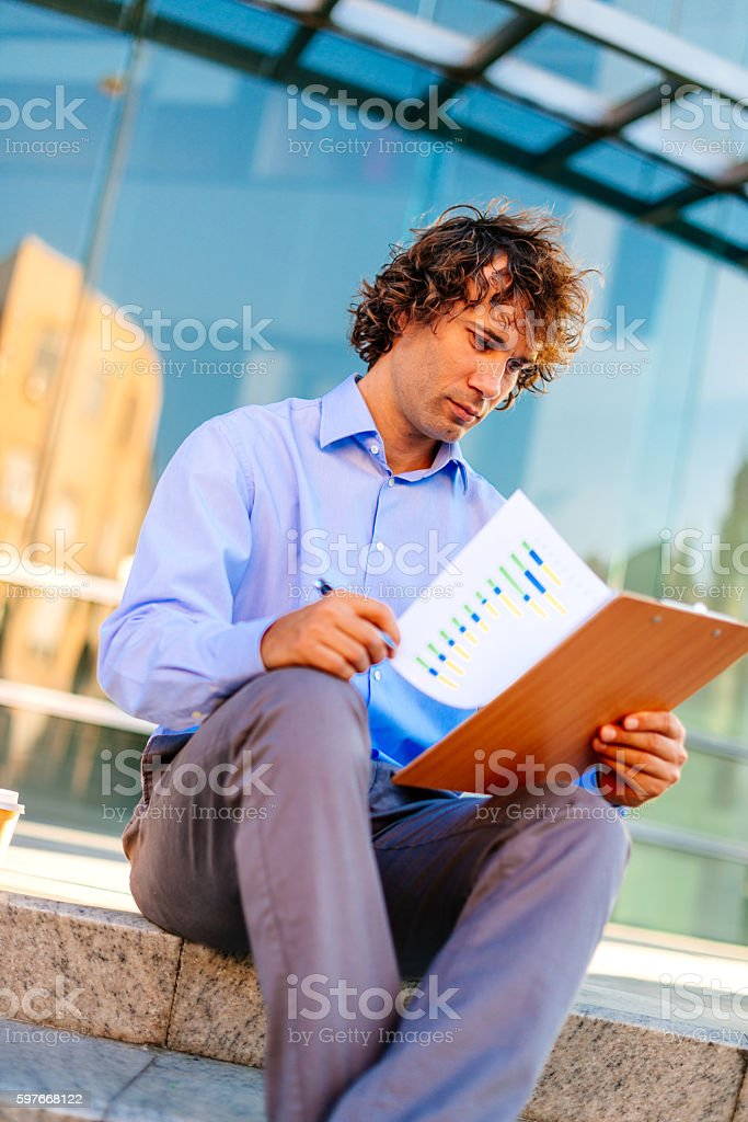 Young accountant dealing with financial figures stock photo