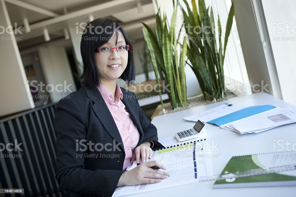 Young accountant focussing on her work royalty-free stock photo