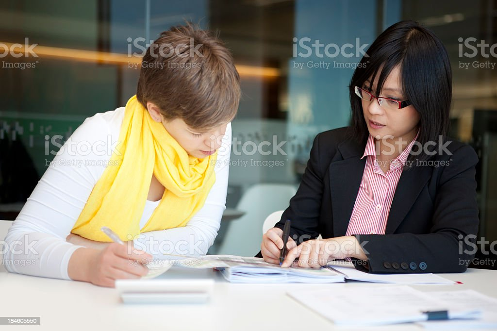 A young accountant with a glasses in a meeting in the office royalty-free stock photo