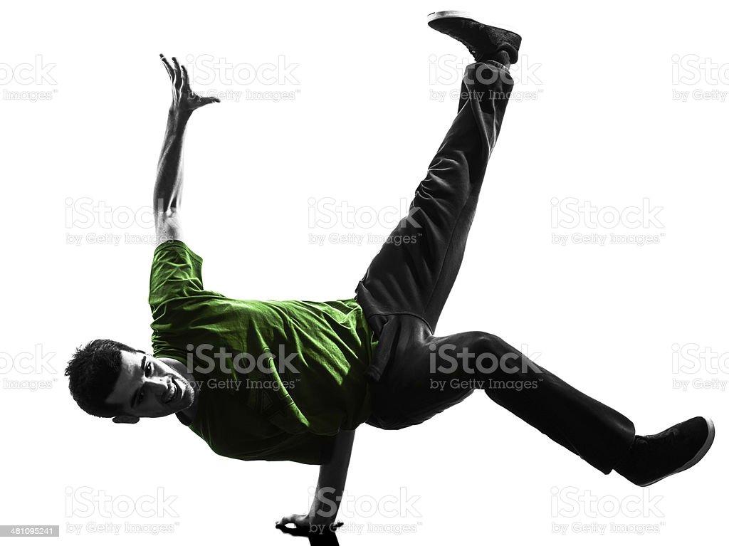 young acrobatic break dancer breakdancing man silhouette stock photo