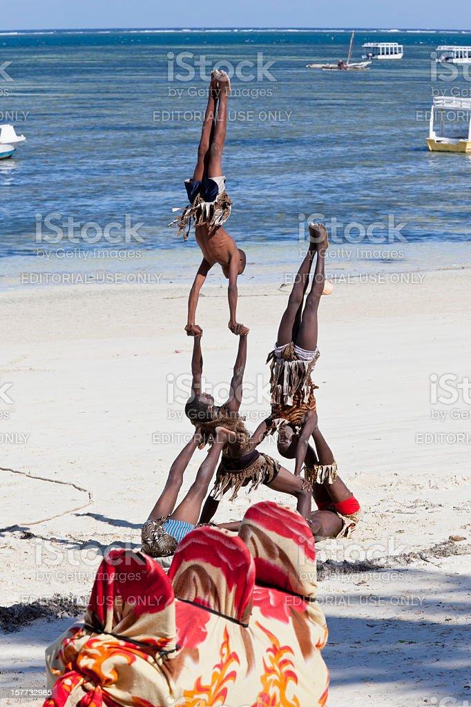 Young Acrobats at Bamburi Beach stock photo