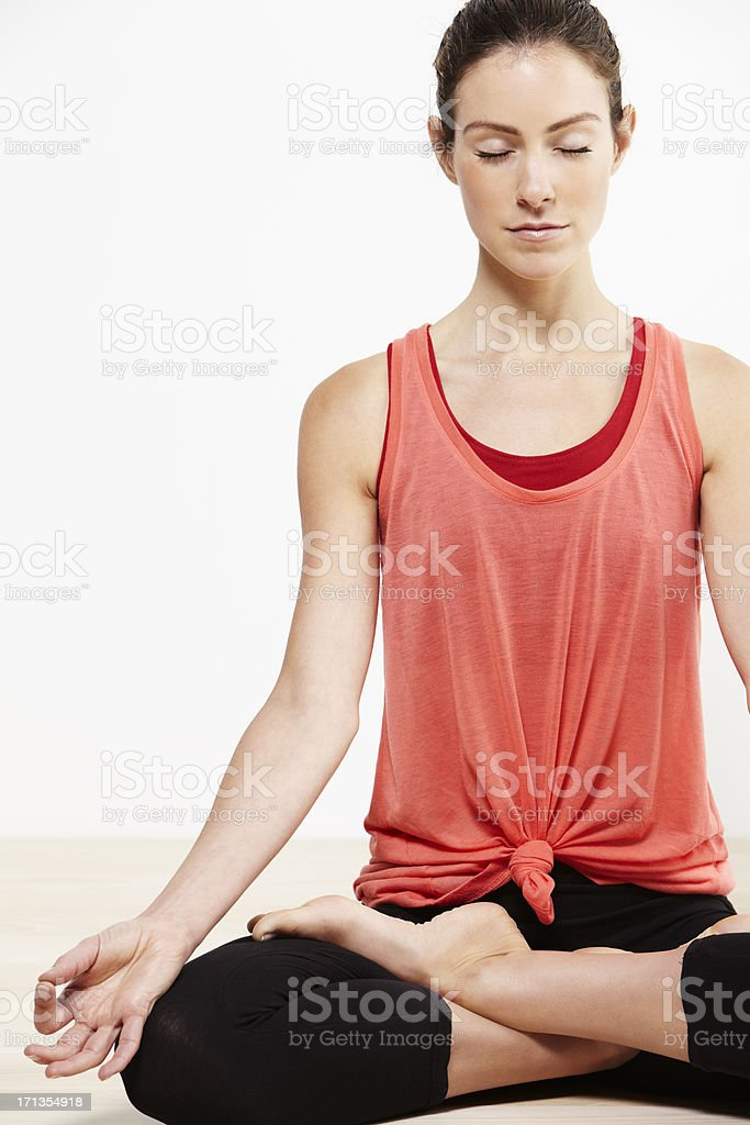 Young active woman doing yoga stock photo