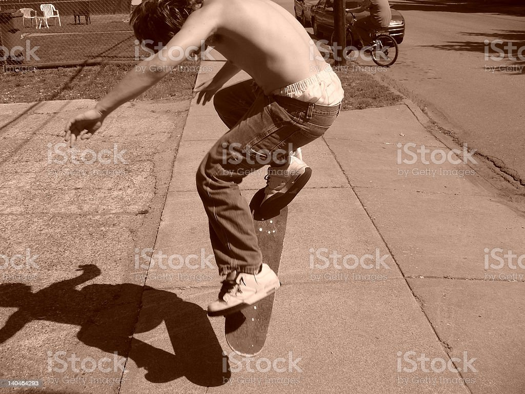 Young adolescent Skateboarding. stock photo