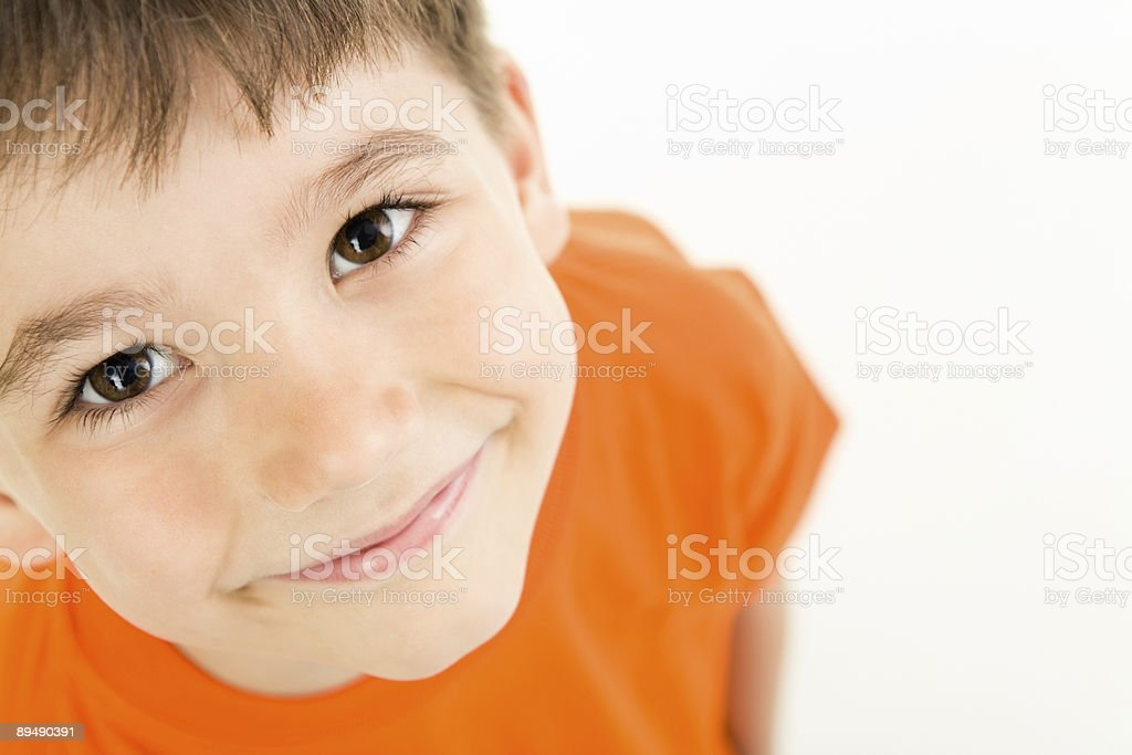 A young adorable boy smiling at the camera stock photo