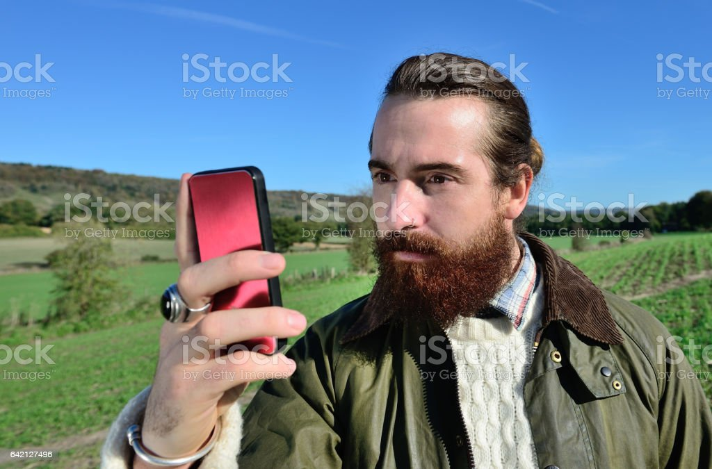 Young adult and one mobile phone, fall clothes stock photo