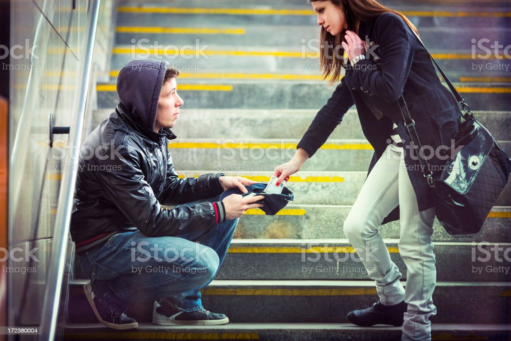 Young adult begging on the streets of Europe stock photo
