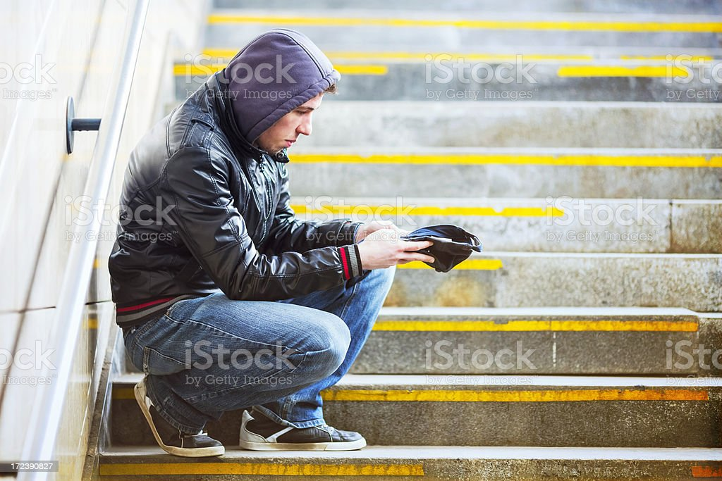 Young adult begging on the streets of Europe royalty-free stock photo