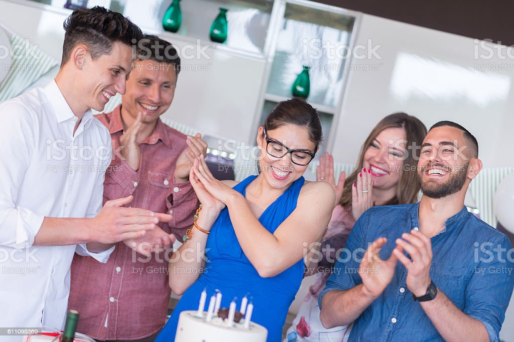 Young adult birthday party: Congratulating the birthday girl stock photo