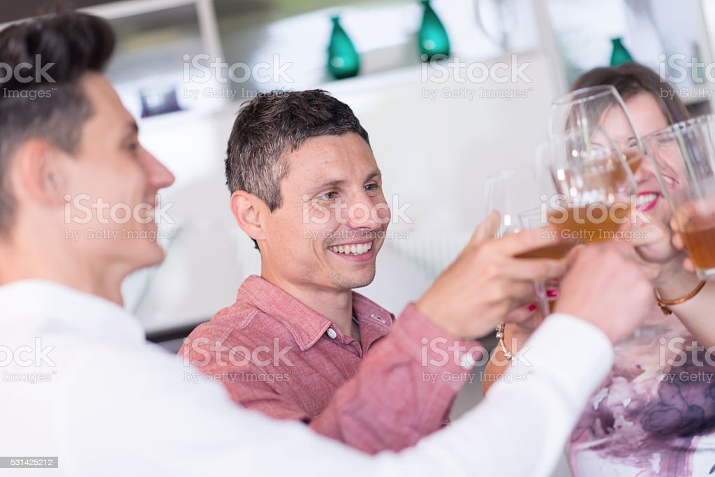 Young adult birthday party: drink toasting stock photo