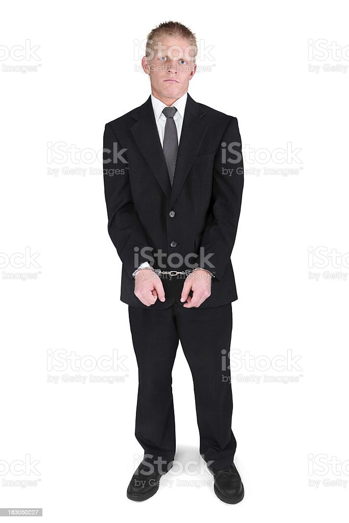 Young adult businessman handcuffed sad face royalty-free stock photo