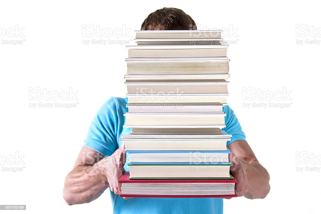 Young adult carrying a stack of books royalty-free stock photo