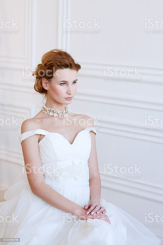 Young adult caucasian bride in a white bridal gown stock photo