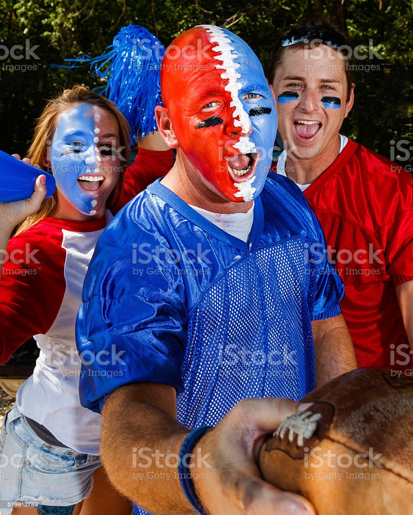 Young Adult College Football Fans Tailgating - Intense Excitement stock photo