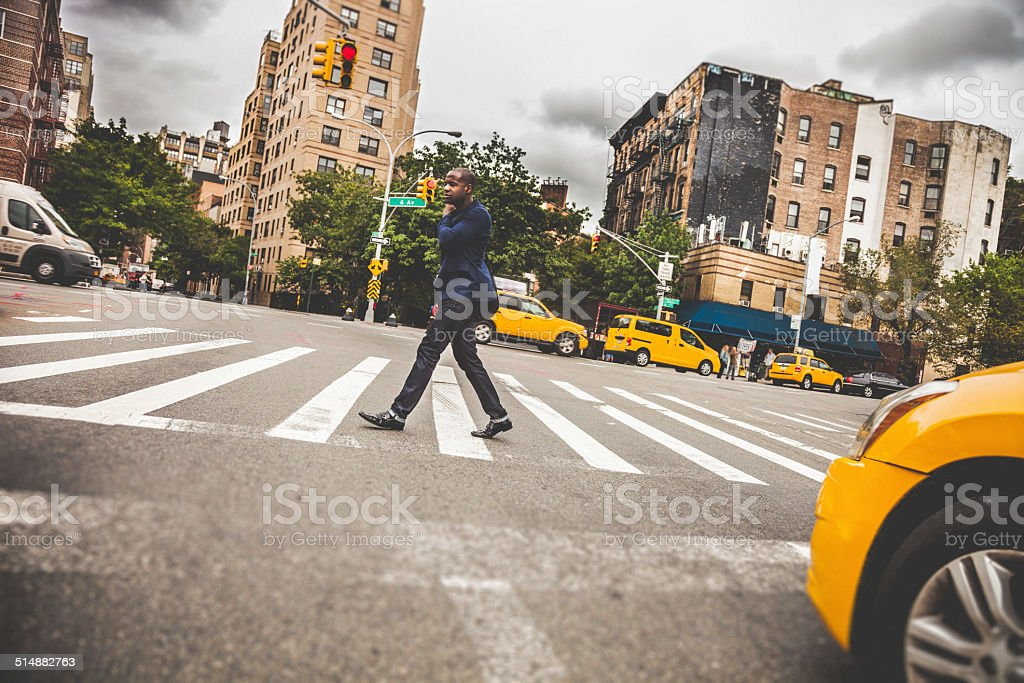 Young adult commuter going at work in the city streets stock photo