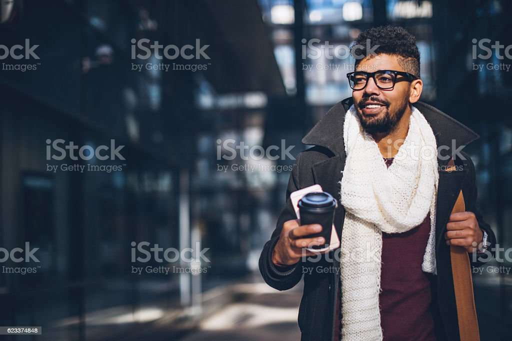 Young adult commuter going at work stock photo
