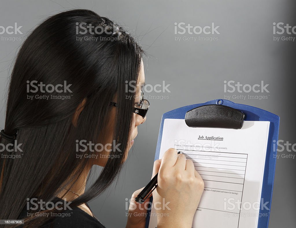 young adult completing job application stock photo 182497905 istock young adult completing job application royalty stock photo