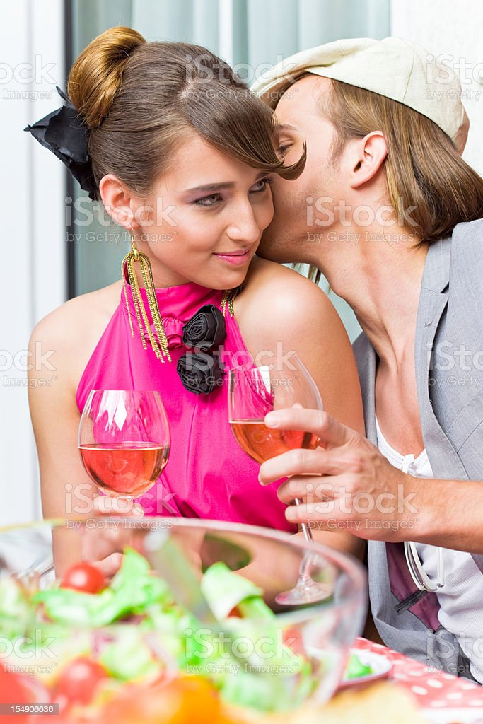 Young adult couple at the party royalty-free stock photo