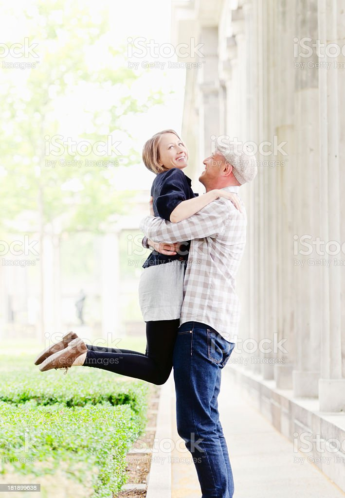 Young adult couple embracing royalty-free stock photo