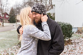 Young adult couple hugging outdoors