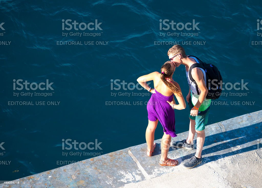 Young adult couple kissing stock photo