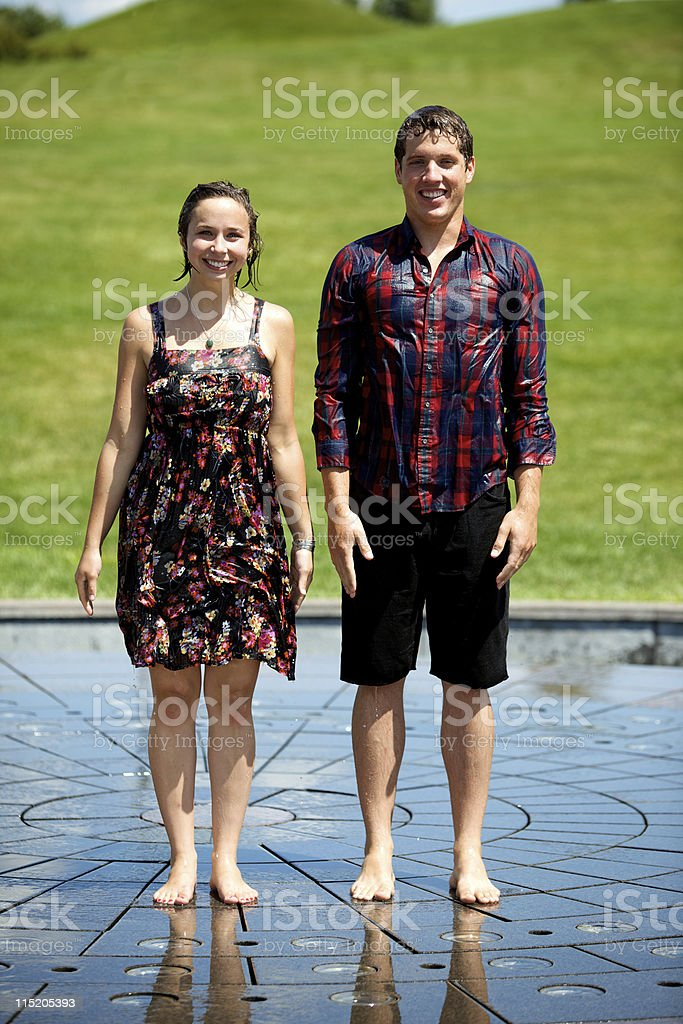 young adult couple outdoors stock photo