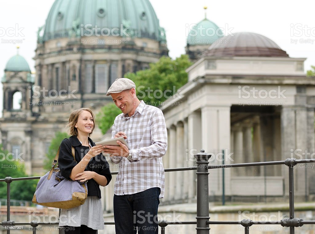Young adult couple with digital tablet in Berlin royalty-free stock photo