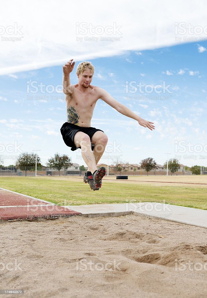 Young adult doing long jump. royalty-free stock photo