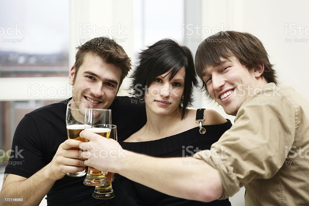 Young adult drinking beer royalty-free stock photo