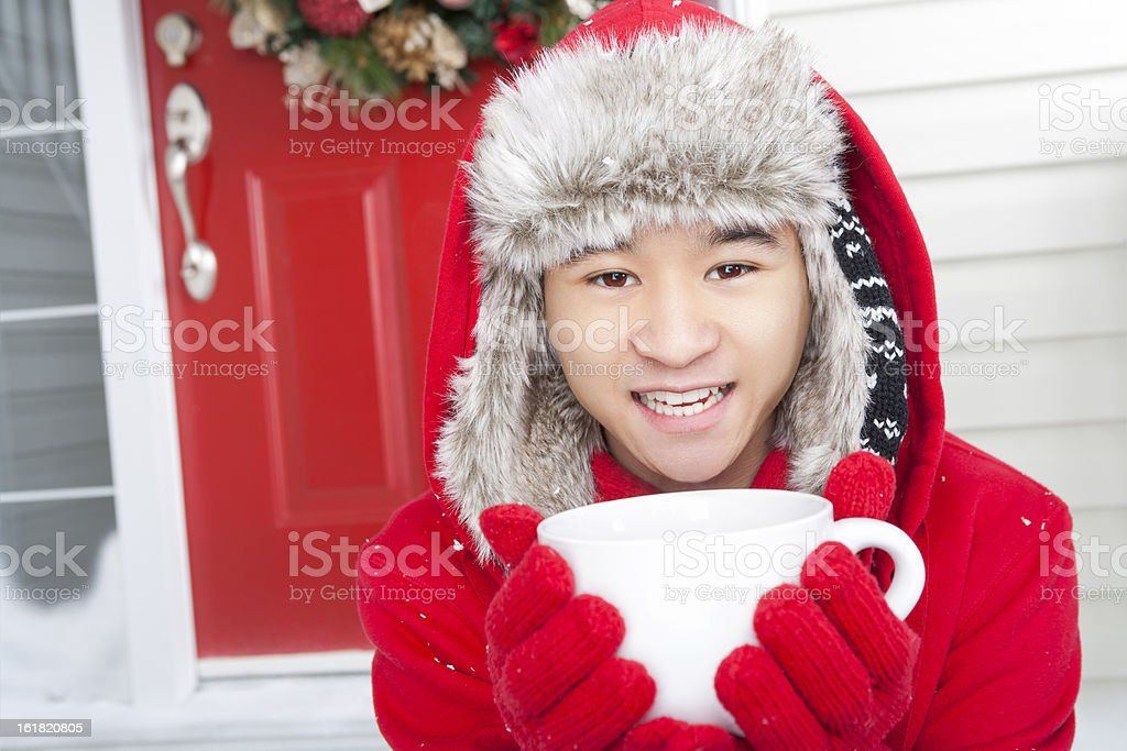 Young adult enjoying a hot beverage royalty-free stock photo